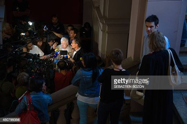 Andre Bamberski and his lawyer Thierry Moser speak to the press after a verdict was handed down during his trial in Mulhouse on June 18, 2014....