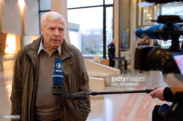 Andre Bamberski, answers journalists' questions as he arrives to attend the trial of Dieter Krombach, accused of the killing of his daughter Kalinka...