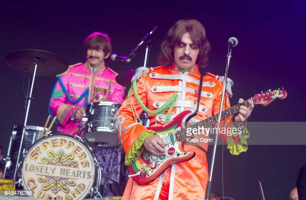 Andre Barreau and Hugo Degenhardt of The Bootleg Beatles perform with The Royal Liverpool Philharmonic Orchestraperforms at Festival No 6 on...