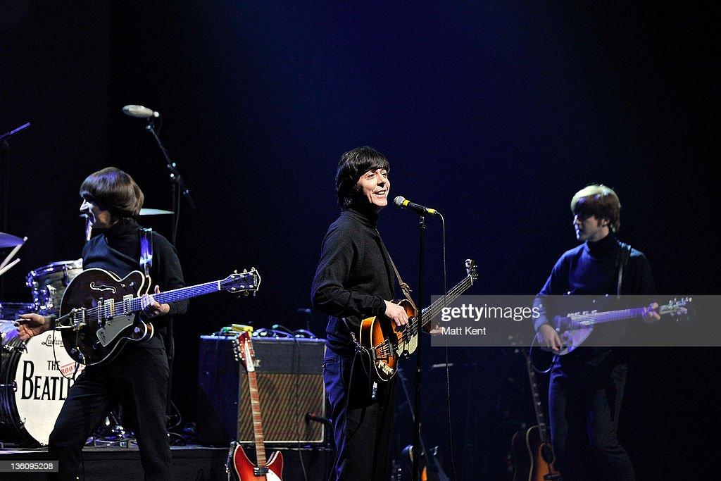 Andre Barreau (George Harrison), David Catlin-Birch (Paul McCartney) and Adam Hastings (John Lennon) of The Bootleg Beatles perform on stage at HMV Hammersmith Apollo on December 19, 2011 in London, United Kingdom.