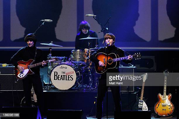 Andre Barreau Hugo Degenhardt and Adam Hastings of The Bootleg Beatles perform on stage at HMV Hammersmith Apollo on December 19 2011 in London...