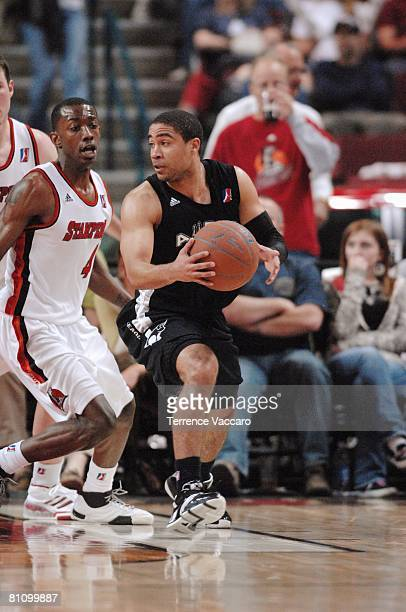 Andre Barrett of the Austin Toros looks to pass against Mike Taylor of the Idaho Stampede in Game Three of the DLeague Finals on April 25 2008 at the...