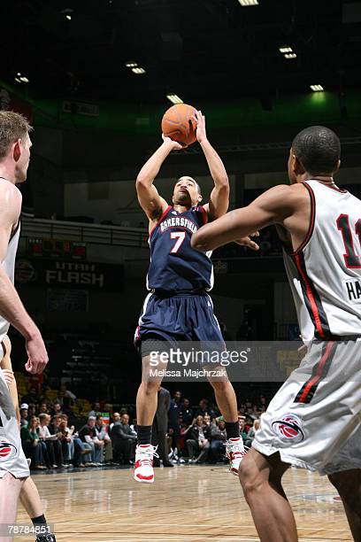 Andre Barrett of the Bakersfield Jam takes a shot up against Brian Jackson and Brian Hamilton of the Utah Flash on January 04 2008 at the David O...