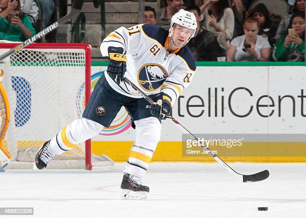 Andre Benoit of the Buffalo Sabres makes a pass to a teammate against the Dallas Stars at the American Airlines Center on March 23 2015 in Dallas...