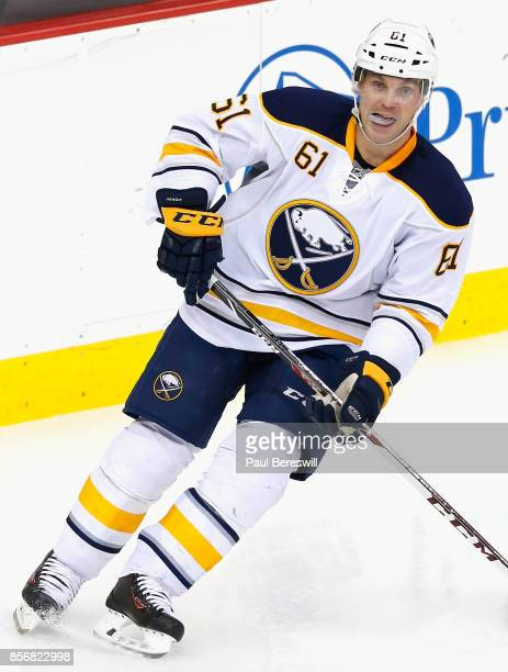 Andre Benoit of the Buffalo Sabres plays in a game against the New Jersey Devils at Prudential Center on February 17 2015 in Newark New Jersey