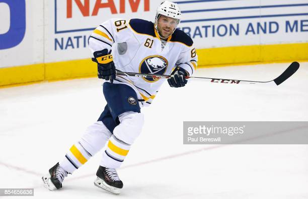 Andre Benoit of the Buffalo Sabres plays in the game against the New York Islanders at Barclays Center on April 4 2015 in Brooklyn borough of New...