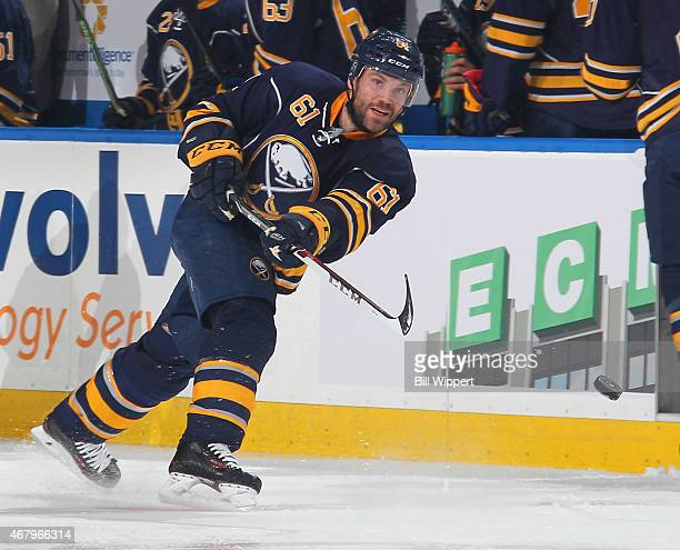 Andre Benoit of the Buffalo Sabres takes a shot against the New Jersey Devils on March 20 2015 at the First Niagara Center in Buffalo New York