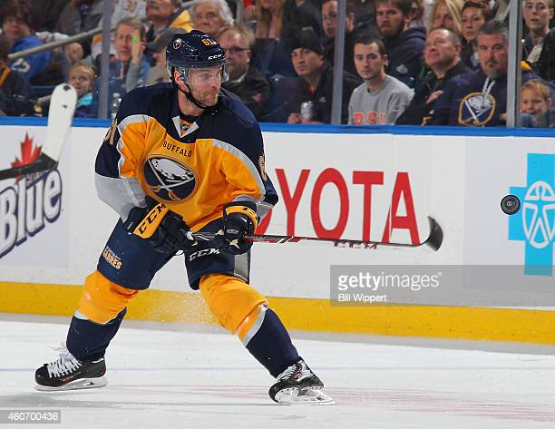 Andre Benoit of the Buffalo Sabres tries to control the puck against the Florida Panthers on December 13 2014 at the First Niagara Center in Buffalo...