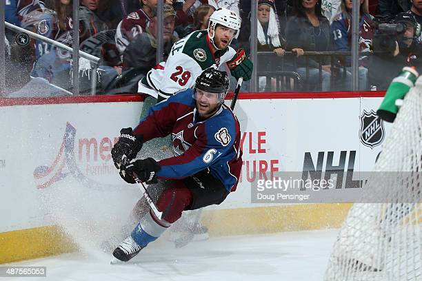 Andre Benoit of the Colorado Avalanche clears the puck away from Jason Pominville of the Minnesota Wild in Game Seven of the First Round of the 2014...