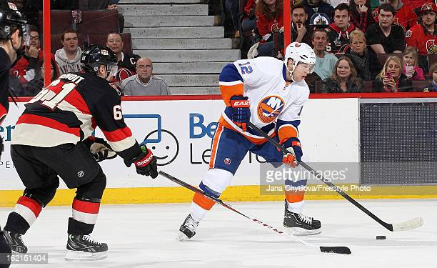Andre Benoit of the Ottawa Senators defends against Josh Bailey of the New York Islanders during an NHL game at Scotiabank Place on February 19 2013...
