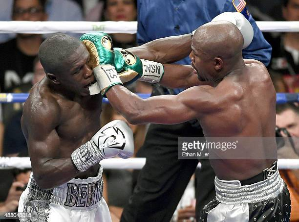 Andre Berto and Floyd Mayweather Jr battle in the 11th round of their WBC/WBA welterweight title fight at MGM Grand Garden Arena on September 12 2015...