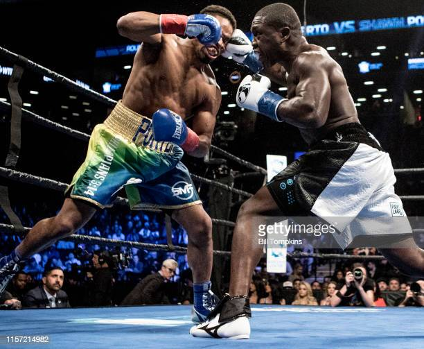 Andre Berto connects with a right punch to Shawn Porter's face in his loss by TKO in the 9th round of their WBC welterweight title eliminator at the...