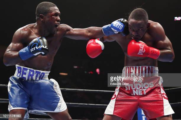 Andre Berto lands a left hand against Devon Alexander Berto would win by split decision at the Nassau Veterans Memorial Coliseum on August 4 2018 in...