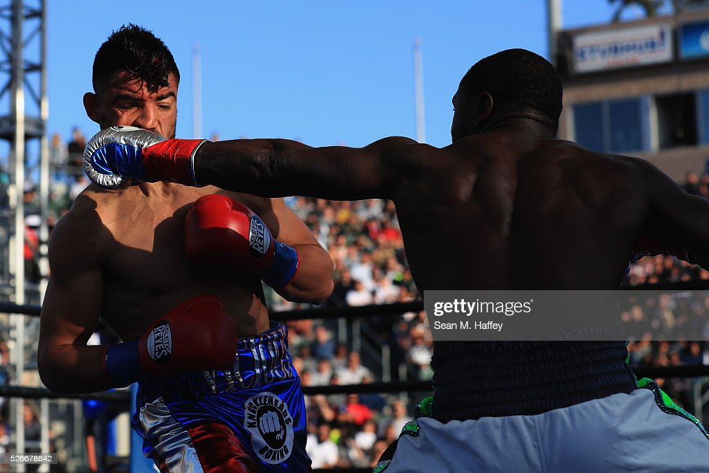 Andre Berto (R) punches Victor Ortiz during a welterweight fight at StubHub Center on April 30, 2016 in Carson, California. Andre Berto defeated Victor Ortiz in the fourth round with a knockout.