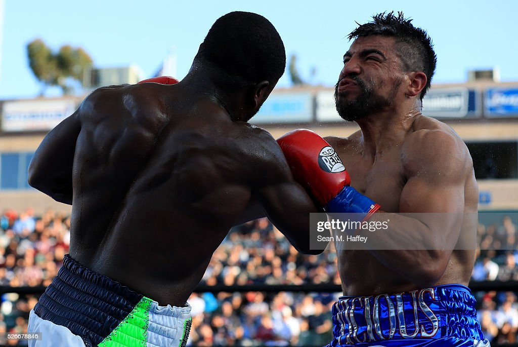 Andre Berto (L) punches Victor Ortiz during a welterweight fight at StubHub Center on April 30, 2016 in Carson, California. Andre Berto defeated Victor Ortiz in the fourth round with a knockout.