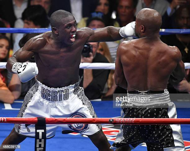 Andre Berto throws a left at Floyd Mayweather Jr in the third round of their WBC/WBA welterweight title fight at MGM Grand Garden Arena on September...