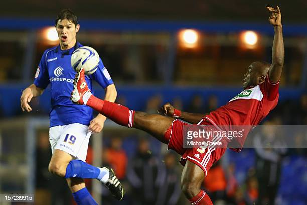 Andre Bikey of Middlesbrugh clears from Nikola Zigic of Birmingham City during the npower Championship match between Birmingham City and...