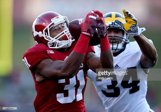 Andre Booker of the Indiana Hoosiers reaches out to catch a pass against the Michigan Wolverines at Memorial Stadium on November 14 2015 in...