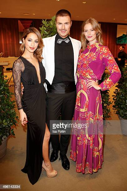Andre Borchers Gizem Emre and Charlott Cordes attend the 22nd Opera Gala at Deutsche Oper Berlin on November 7 2015 in Berlin Germany