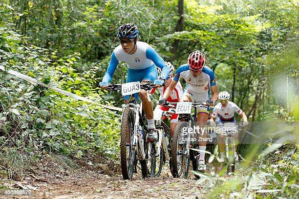 Andre Bos of Guatemala competes in the Men's Team Event Cross country on day four of Nanjing 2014 Summer Youth Olympic Games at Laoshan Mountain Bike...