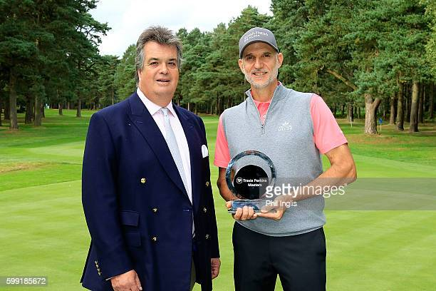 Andre Bossert of Switzerland receives the trophy from His Grace the Duke of Bedford after the final round of the Travis Perkins Masters played on the...
