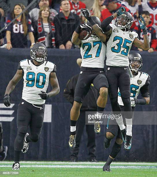 Andre Branch Demetrius McCray celebrate Dwayne Gratz of the Jacksonville Jaguars touchdown against the Houston Texans in the first quarter in a NFL...