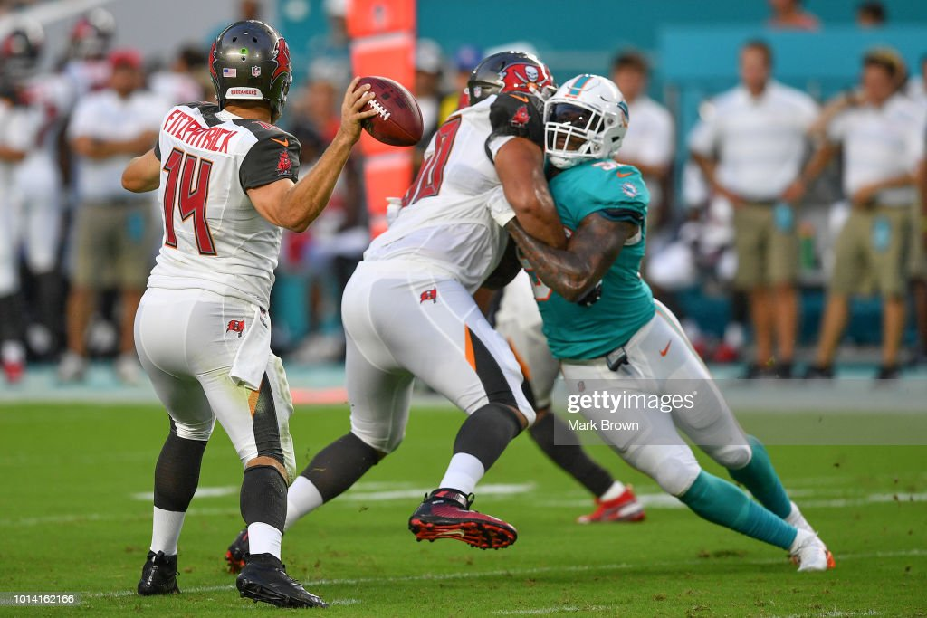 Andre Branch #50 of the Miami Dolphins rushes towards Ryan Fitzpatrick #14 of the Tampa Bay Buccaneers in the first quarter during a preseason game at Hard Rock Stadium on August 9, 2018 in Miami, Florida.