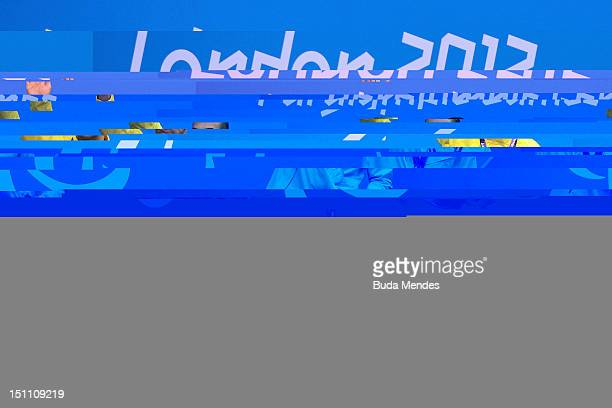 Andre Brasil of Brazil celebrates a gold medal in the Men's 50m freestyle during the 3rd Day of the London 2012 Paralympic Games at Aquatics Centre...