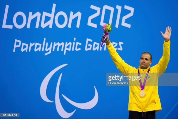 Andre Brasil of Brazil celebrates after winning the Men's 50m freestyle on day 2 of the London 2012 Paralympic Games at Aquatics Centre on August 31...