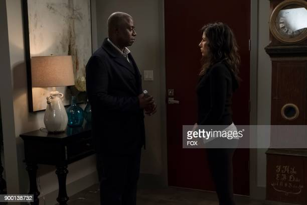 Andre Braugher and Stephanie Beatriz in the Game Night Godfather special one hour episode of BROOKLYN NINENINE airing Tuesday Dec 12 on FOX