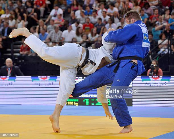 Andre Breitbarth of Germany attacks Matjaz Ceraj of Slovenia in their 100kg bronze medal match that the German won at the Montpellier European Judo...