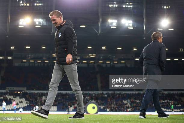 Andre Breitenreiter head coach of Hannover and Julian Nagelsmann head coach of Hoffenheim on the pitch prior to the Bundesliga match between Hannover...