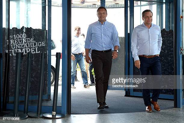 Andre Breitenreiter the newly appointed head coach of FC Schalke 04 and manager Horst Heldt arrive for a press conference at Veltins Arena on June 15...