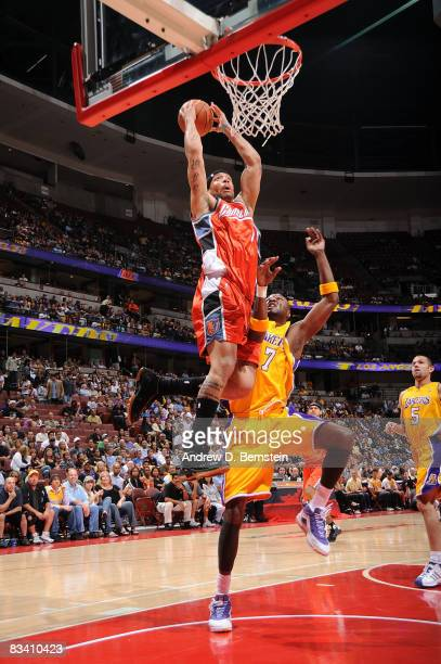 Andre Brown of the Charlotte Bobcats goes up for a shot over Lamar Odom of the Los Angeles Lakers October 23 2008 at Honda Center in Anaheim...