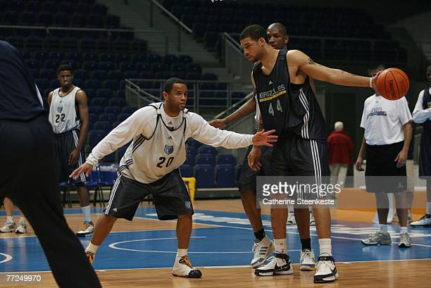 Andre Brown playes against Damon Stoudamire during open practice of the Memphis Grizzlies during the EA Sports NBA Europe Live Tour at Palacio de...