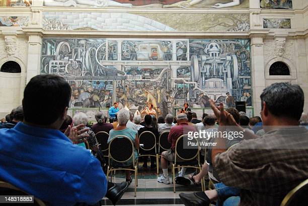 Andre Brunet PierreLuc Dupuis and Eric Beaudry of De Temps Antan perform in Rivera Court with the Detroit Industry murals of Mexican artist Diego...
