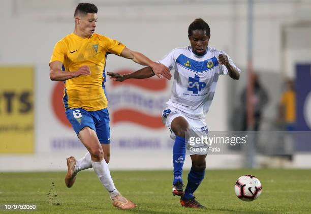 Andre Bukia of FC Arouca with Filipe Soares of GD Estoril Praia in action during the Ledman Liga Pro match between GD Estoril Praia and FC Arouca at...