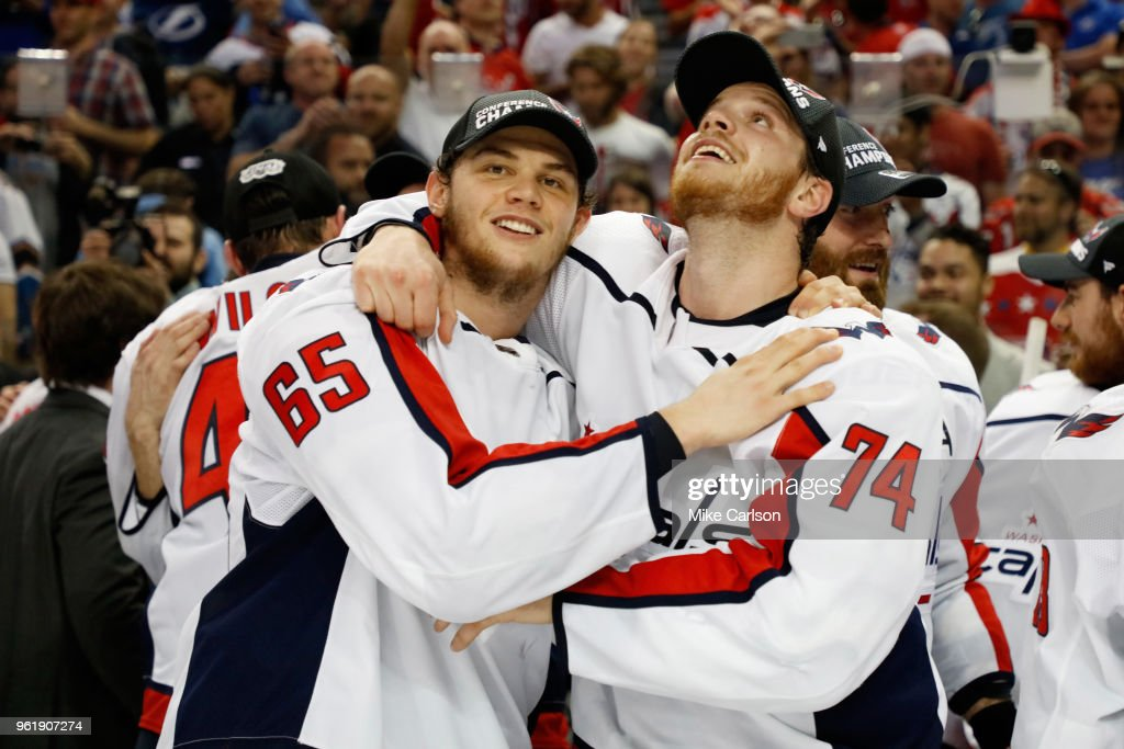 Andre Burakovsky #65 and John Carlson #74 of the Washington Capitals celebrate after defeating the Tampa Bay Lightning in Game Seven of the Eastern Conference Finals during the 2018 NHL Stanley Cup Playoffs at Amalie Arena on May 23, 2018 in Tampa, Florida. The Washington Capitals defeated the Tampa Bay Lightning with a score of 4 to 0.