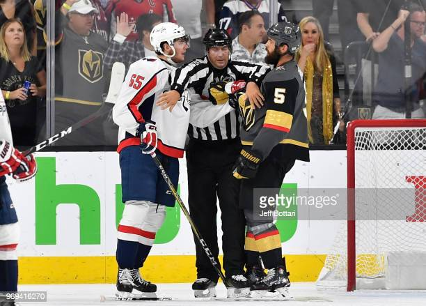 Andre Burakovsky of the Washington Capitals and Deryk Engelland of the Vegas Golden Knights are separated by the referee during the third period in...