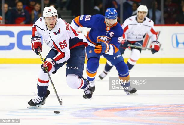 Andre Burakovsky of the Washington Capitals carries the puck up ice as John Tavares of the New York Islanders gives chase during the second period at...