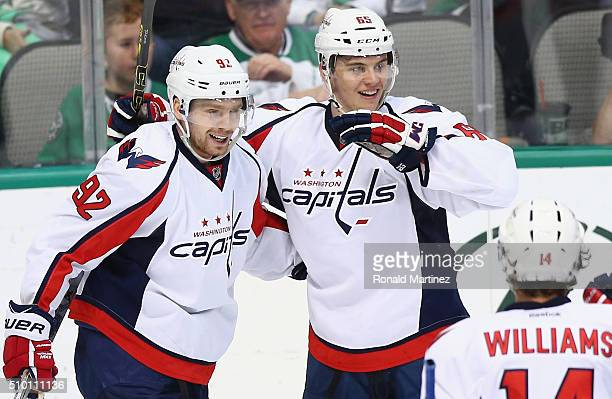 Andre Burakovsky of the Washington Capitals celebrates a goal with Evgeny Kuznetsov against the Dallas Stars in the third period at American Airlines...