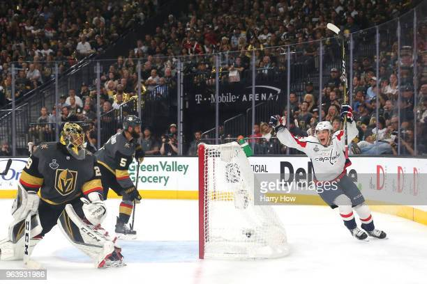 Andre Burakovsky of the Washington Capitals celebrates a secondperiod goal by teammate Brooks Orpik as MarcAndre Fleury of the Vegas Golden Knights...
