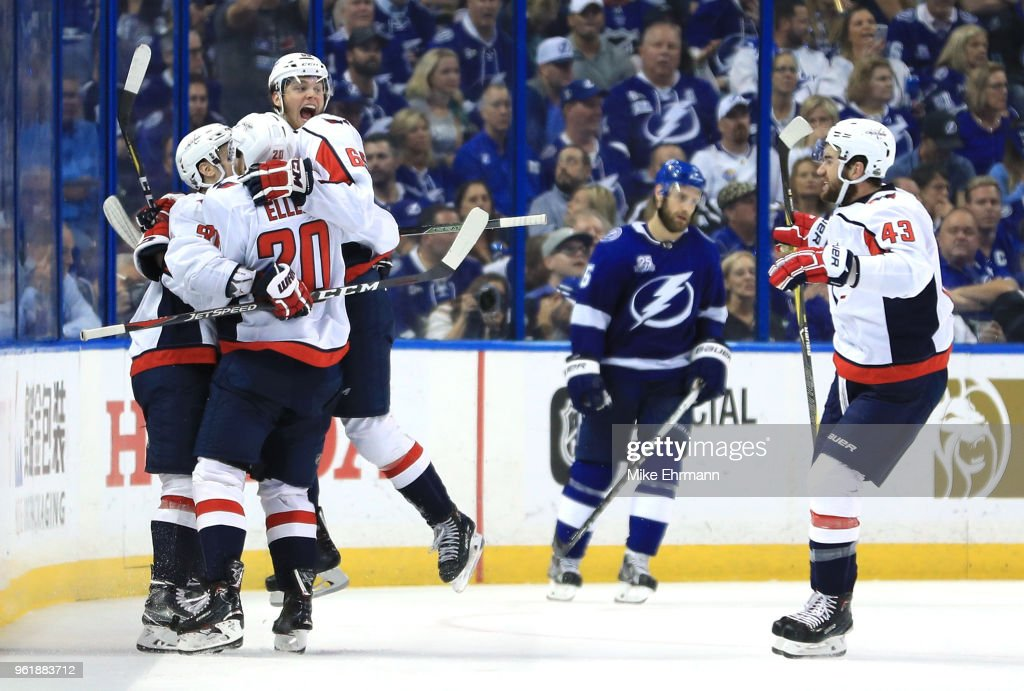 Andre Burakovsky #65 of the Washington Capitals celebrates with his teammates Dmitry Orlov #9, Lars Eller #20 and Tom Wilson #43 of the Washington Capitals after scoring a goal against Andrei Vasilevskiy #88 of the Tampa Bay Lightning during the second period in Game Seven of the Eastern Conference Finals during the 2018 NHL Stanley Cup Playoffs at Amalie Arena on May 23, 2018 in Tampa, Florida.