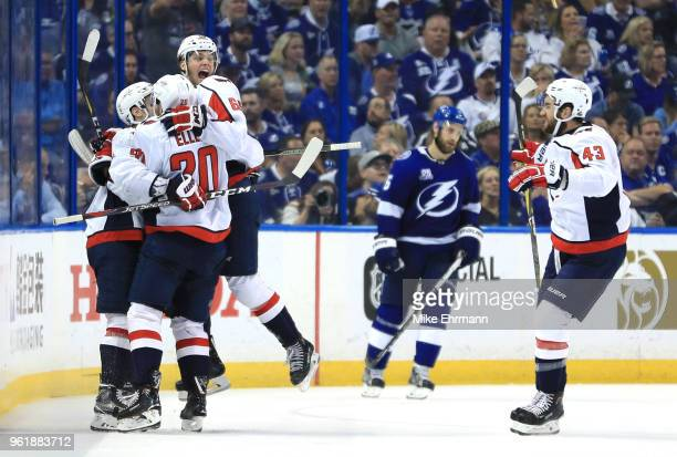 Andre Burakovsky of the Washington Capitals celebrates with his teammates Dmitry Orlov Lars Eller and Tom Wilson of the Washington Capitals after...