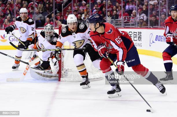 Andre Burakovsky of the Washington Capitals controls the puck against Brandon Montour of the Anaheim Ducks in the third period at Capital One Arena...