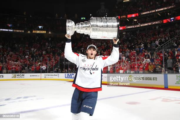 Andre Burakovsky of the Washington Capitals hoists the Stanley Cup after his team defeated the Vegas Golden Knights 43 in Game Five of the 2018 NHL...