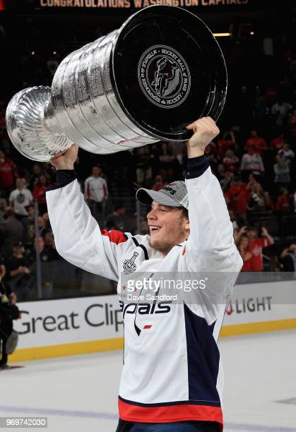 Andre Burakovsky of the Washington Capitals lifts the Stanley Cup in celebration after his team defeated the Vegas Golden Knights 43 in Game Five of...