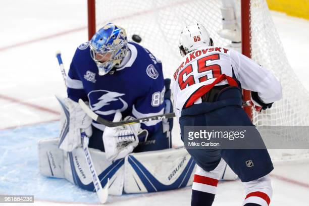 Andre Burakovsky of the Washington Capitals scores a goal against Andrei Vasilevskiy of the Tampa Bay Lightning during the second period in Game...