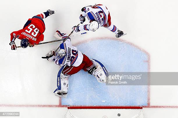 Andre Burakovsky of the Washington Capitals scores the gamewinning goal in front of Ryan McDonagh and goalie Henrik Lundqvist of the New York Rangers...