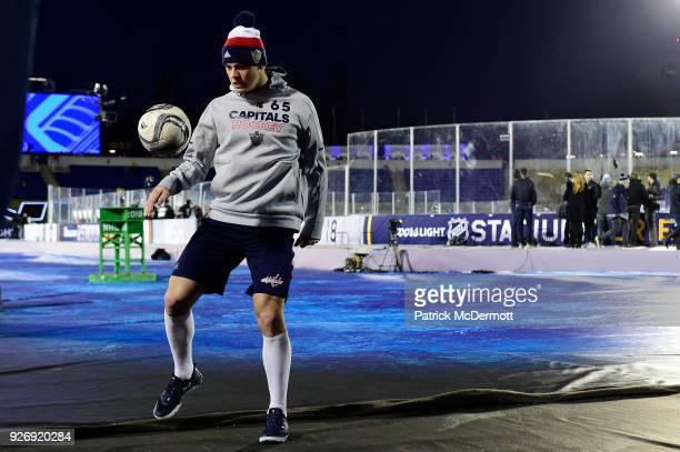 Andre Burakovsky of the Washington Capitals volleys a soccer ball during warmup prior to the 2018 Coors Light NHL Stadium Series game against the...